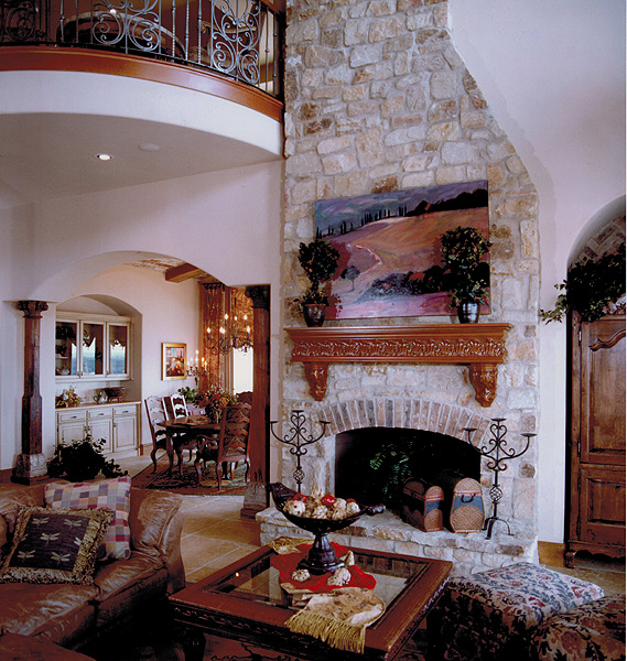 Interior design with two story fireplace and balcony