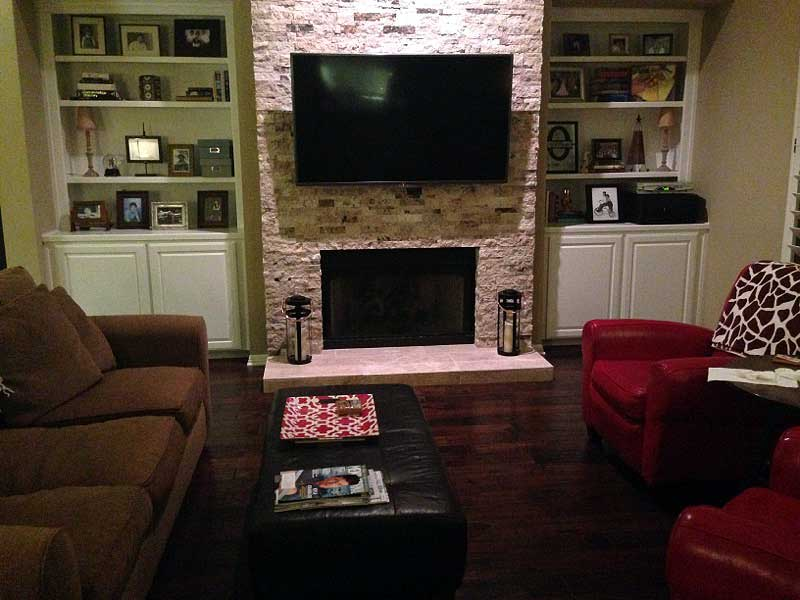 Fireplace facelift with stacked stone replacing brick.