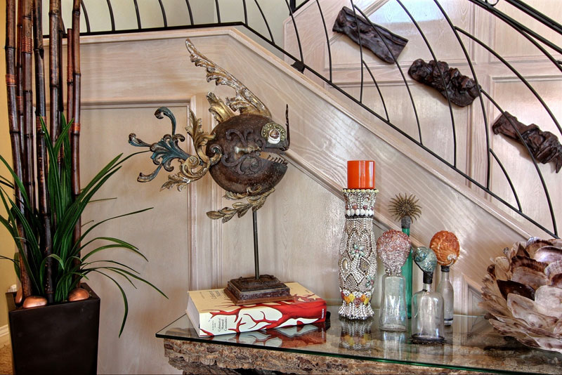 Arrangement of personalized objects to add interest to home decor